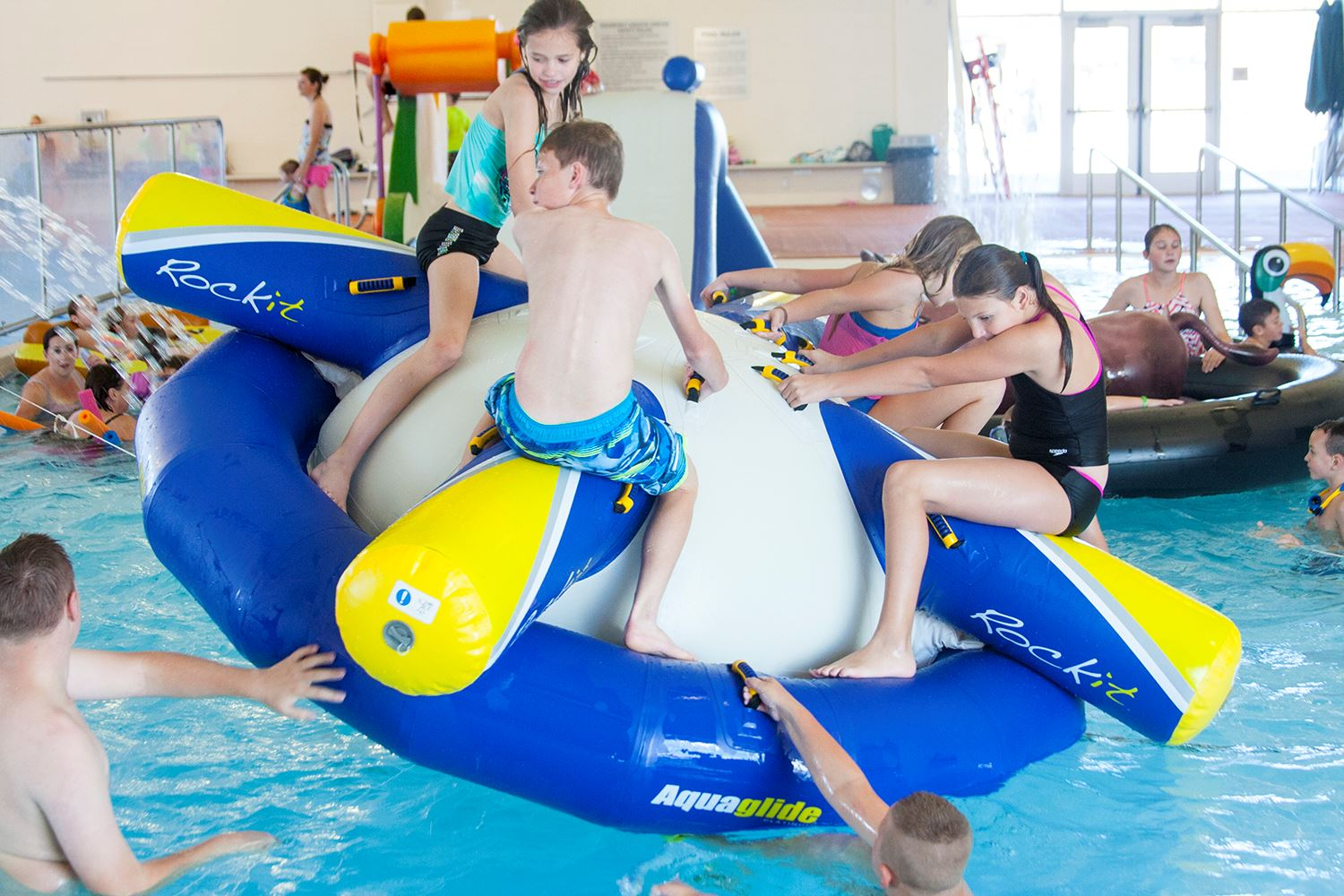 children at pool on inflatable